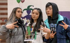 Shorewood Varsity Hip Hop captains hold the 2nd place trophy their team won at Edmonds Woodway High School earlier this school year. They also qualified for districts with more points than they have ever received.