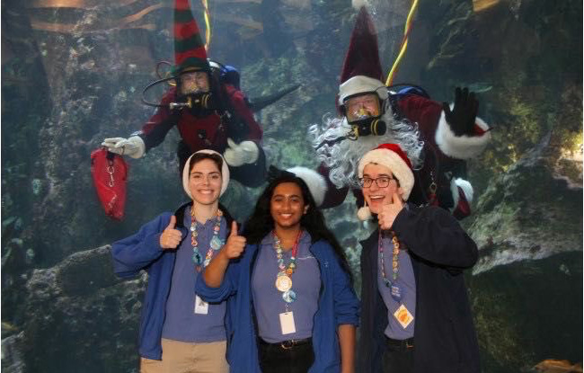 Pictured far right. Chris Cummings at a Seattle Aquarium event.