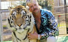 Joe Exotic poses with one of his wild cats in
