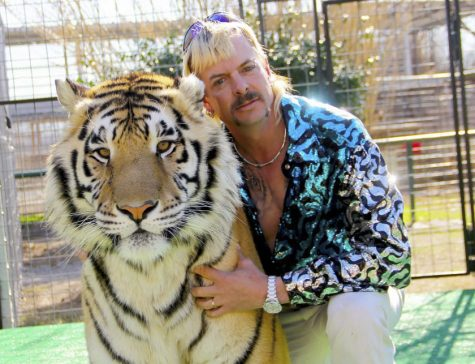 "Joe Exotic poses with one of his wild cats in ""Tiger King."" (Netflix)"